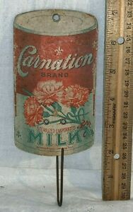 ANTIQUE CARNATION EVAPORATED MILK DIE CUT CAN BILL HOLDER SIGN COUNTRY STORE TIN
