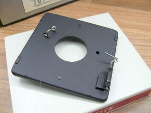 Graflex Cat #9702 Lens board assembly w/ Copal '0' lens hole. NIB.