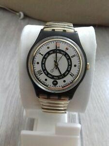 Montre Swatch Standards 1996 - GM710 - Grosser Nougat avec date et jour