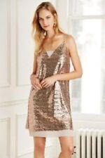 Vestiti da donna in oro in paillettes con scollo a v