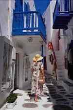657083 Girl In Street Mykonos Greece A4 Photo Print
