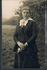 RP POSTCARD YOUNG EDWARDIAN WOMAN IN RURAL SCENE WITH A SMALL POSY C1907