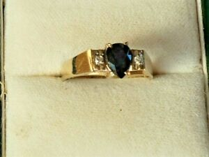 Diamond Ring .Tear  shape Blue Sapphire and Diamonds  in all 9ct yellow Gold