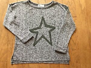 H&M JUMPER, TOP/ AGE 8-10/ BLACK STAR/ SPLIT SIDES/ SOFT TOUCH