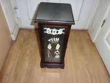 Vintage solid wood cabinet with nautical items glass door