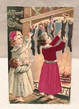 Victorian Antique SILK Embossed Christmas Postcard Children Hanging Stockings