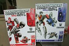 2 lot HasbroTRANSFORMERS CONSTRUCT BOTS IRON HIDE AND STARSCREAM, sealed-new