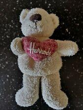 HARRODS TEDDY BEANIE HOLDING A HEART WITH HARRODS ON IT