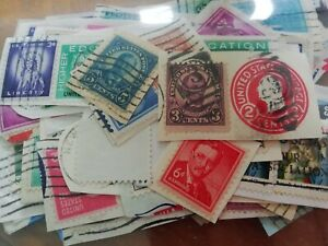 Interesting lot of 100 old stamps from USA. On paper. VGU.