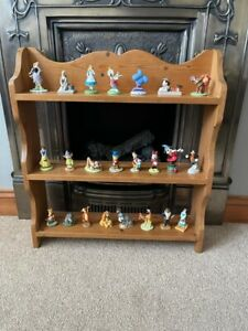 Grolier Disney x 23 Porcelain Ornaments 3 inch Stand is available