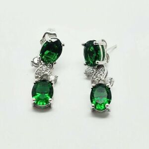 White gold finish oval green emerald and created diamond earrings
