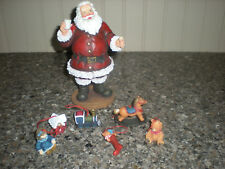 Roman Inc. Christmas Magic of Giving Santa figurine & 6 toy figurine ornaments