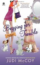 Begging for Trouble: A Dog Walker Mystery by Judi McCoy