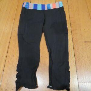 IVIVVA LULULEMON girls black multi capris crop cinch leggings pant pocket Sz 12