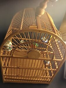 Chinese Bamboo Bird Cage With A Bird And Porcelain Feeders