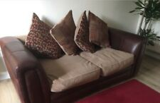 Two seater leather brown sofa with scatter cushions