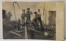 Wheatland Wyoming Klassart Family Posing on Farm Equipment RPPC Postcard F9