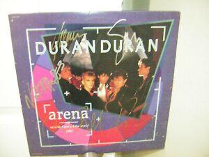 Duran Duran signed lp **Arena **1985**5 members **Simon Le Bon ***