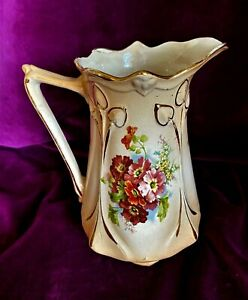 Vintage blush ivory jug painted with  flowers 19cm tall