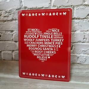 Red Metal Sign With White Heart Filled With Christmas Phrases