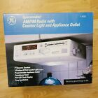 GE Spacemaker 7-4232 AM/FM Radio with Counter Light and Appliance Outlet photo