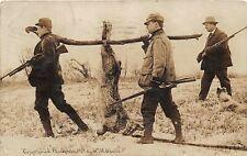 F24/ Independence Iowa RPPC Postcard 1910 Exaggeration Rabbit Hunt