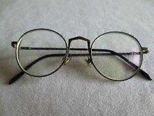 Gentle Monster gunmetal round glasses frames. Liberty.