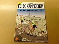 STRIP / F.C. DE KAMPIOENEN 31: KAMPIOENEN OP WIELEN   1ste druk