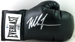 Mike Tyson Autographed Black Everlast Boxing Glove- Beckett Auth *Right