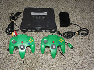 Nintendo 64 Console + Jumper + 2 Green Controllers