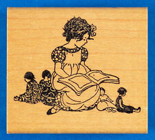 Little Girl Reading a Book to Her Dolls Stamp by Rubber Monger - Rare