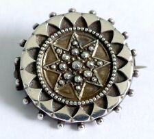 A VICTORIAN UNMARKED SILVER TARGET BROOCH WITH LOCKET BACK