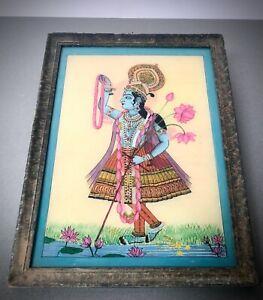 VINTAGE INDIAN REVERSE GLASS PAINTING. HINDU DEITY KRISHNA. CELEBRATION OF LOTUS