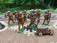 11 Antique World War I Doughboy Metal Toy Soldiers and One Military Truck