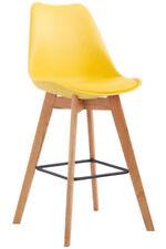 Chaises jaunes en plastique pour la salle à manger