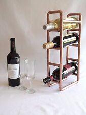 Copper wine rack by Artisan Craftworks