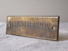 9,5 X 3 cm - Ancienne plaquette en laiton de porte, cinéma......WARNER BROS