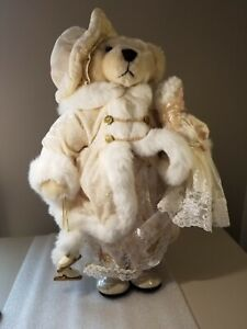 Creative Designs Ltd  Bear holding doll and ice skates with fur coat and hat