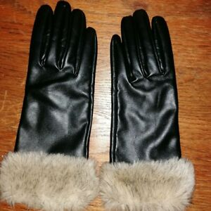 Black real leather vintage gloves with I think a faux fur trim? Excellent condit