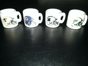 A Lot Of Four NFL Mini Coffee Mugs new condition never been used four different