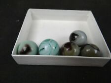 west virginia swirls marbles,five pieces,one with oxblood,played with