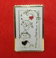 THE MARCH CO POSTAGE STAMP PIN 1984 GOLD TONED LAPEL PIN 20 CENT CHILDREN RARE