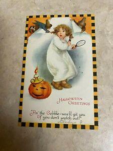 1925 HALLOWEEN POSTCARD LIGHTED  PUMPKIN  WITH CHILD