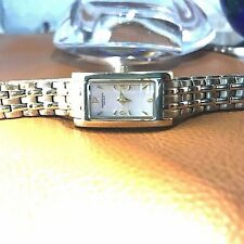 KENNETH COLE:Goldtone Case, Bezel & Band/Champagne Color Face Ladies Watch.