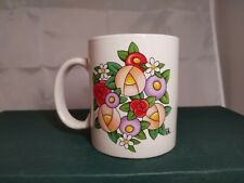 Mary Engelbreit mug/cup, bouquet of stylized flowers