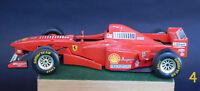 BURAGO Ferrari F310B (1997) M. Schumacher scala 1/24