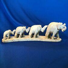 "Euc vintage tan carved stone (onyx?) 6.5""long 4-marching-elephant figurine"