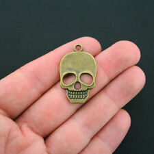 4 Skull Charms Antique Bronze Tone - BC1261