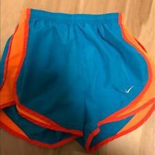 Women's Nike dri fit Xs mini shorts Blue and Orange