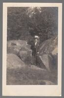 [54115] OLD REAL PHOTO POSTCARD WELL-DRESSED WOMAN POSING NEXT TO BOULDERS